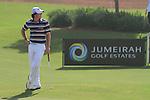 Dubai World Championship Golf. Earth Course,.Jumeirah Golf Estate, Dubai, U.A.E...Rory McIlroy waiting to putt on the third hole during the third round of the Dubai World Golf championship..Photo: Fran Caffrey/www.golffile.ie...