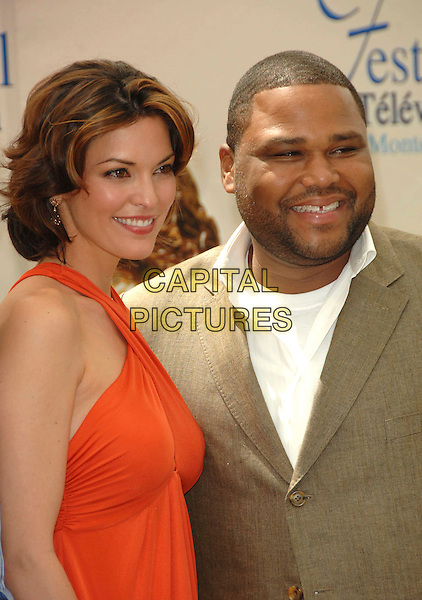 "ALANA DE LA GARZA & ANTHONY ANDERSON.Photocall promoting the television series ""Law And Order"" during the fourth day of the 2008 Monte Carlo Television Festival held at Grimaldi Forum, Monaco, Principality of Monaco,.June 11th, 2008..portrait headshot  red orange dress halterneck cast.CAP/TTL .©TTL/Capital Pictures"