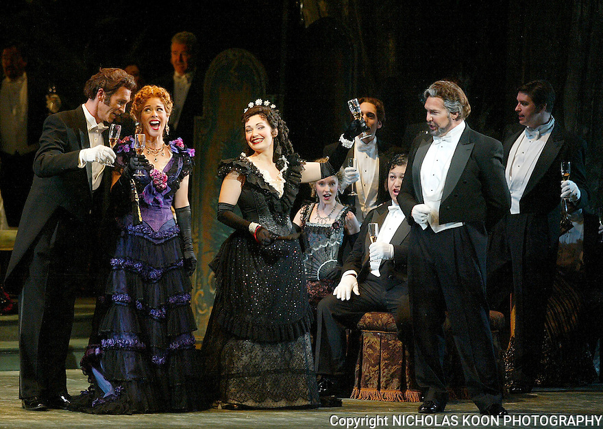 2005 - LA TRAVIATA - Jamie Offenbach as Marchese D'Obigny, Stephanie Woodling as Flora, Dina Kuznetsova as Violetta Valery and Charles Austin as Baron Douphol in act one of Opera Pacific's production of La Traviata.