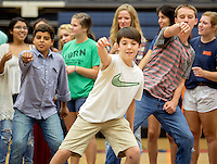 NWA Democrat-Gazette/JASON IVESTER <br /> Rogers Heritage freshmen Keith Saucier (from left), Jude Holmes and Louis Bimbi (cq) strut their moves in a dance-off on Wednesday, Sept. 2, 2015, in the school's gym. Senior members of the Link Crew led a pep rally practice for freshmen.