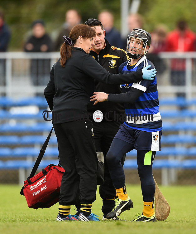 Ger O Connell of Clonlara is checked for an injury during their senior county final against Ballyea at Cusack Park. Photograph by John Kelly.