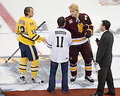 Carl Hagelin (Michigan - 12), Neal Broten, Mike Montgomery (Duluth - 24), Clay Matvick - The University of Minnesota-Duluth Bulldogs defeated the University of Michigan Wolverines 3-2 (OT) to win the 2011 D1 National Championship on Saturday, April 9, 2011, at the Xcel Energy Center in St. Paul, Minnesota.