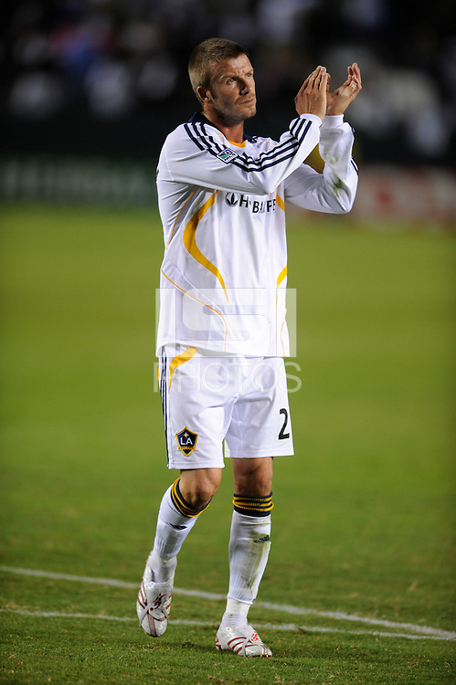 Los Angeles Galaxy's David Beckham salutes the crowd after playing the New York Red Bulls  at the Home Depot Center in Carson, CA on  October 18, 2007. The LA Galaxy and the NY Red Bulls played to a 1-1 tie. (Matt A. Brown)