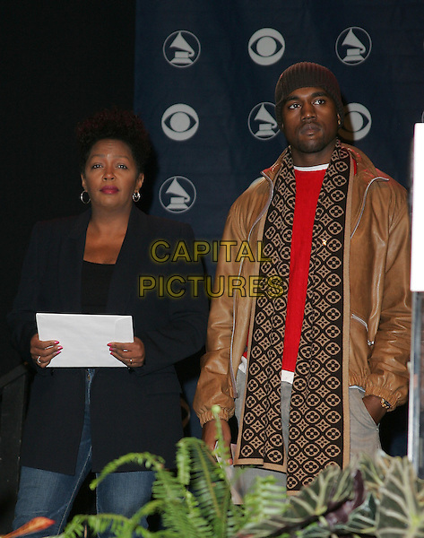 ANITA BAKER & KANYE WEST.The 47th Annual Grammy Award Nominees Announcements. The announcement were held at The Music Box in Hollywood, California .December 7th, 2004.half length, borw leather jacket, scarf, heat, beanie.www.capitalpictures.com.sales@capitalpictures.com.Supplied By Capital PIctures