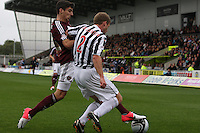 David van Zanten tackles Callum Paterson in the St Mirren v Heart of Midlothian Clydesdale Bank Scottish Premier League match played at St Mirren Park, Paisley on 15.9.12.