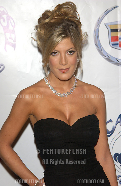 Actress TORI SPELLING at the 15th Carousel of Hope Ball at the Beverly Hilton Hotel, Beverly Hills..15OCT2002.  © Paul Smith / Featureflash