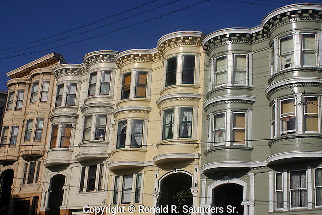 Row of Victorian homes unique for its colorful (colourful) pastel exteriors, and typically seen in<br />