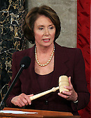 Washington, D.C. - January 4, 2007 --  United States Representative Nancy Pelosi (Democrat of the 8th District of California) holds the gavel after she was sworn-in as the Speaker of the United States House of Representatives in the Capitol in Washington, D.C. on Thursday, January 4, 2007.  Speaker Pelosi is the first woman in U.S. history to serve in that position..Credit: Ron Sachs / CNP