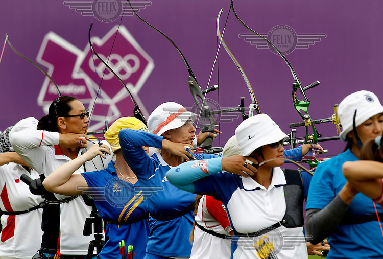 Women compete in an event in the archery competition at the London 2012 Olympic Games.