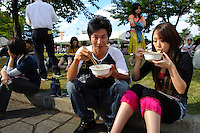 "Visitors to the B1 Grand Prix, Yokote, Akita Pref, Japan, September 19 2009. The B1 Grand Prix is a competition for inexpensive and tasty regional dishes from around Japan. The B stands for ""b-class gourmet"". In 2009 it was held in the northern Japan city of Yokote."