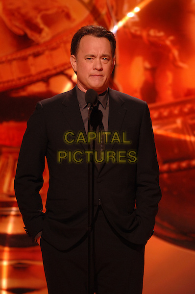 "TOM HANKS.Presents the Cecille B. DeMille award.Telecast - 64th Annual Golden Globe Awards, Beverly Hills HIlton, Beverly Hills, California, USA..January 15th 2007. .globes half length black suit jacket microphone.CAP/AW.Please use accompanying story.Supplied by Capital Pictures.© HFPA"" and ""64th Golden Globe Awards"""