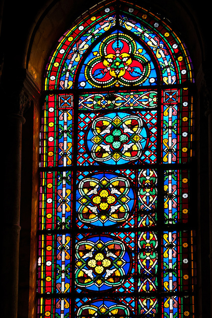 Medieval stained glass from the Gothic Cathedral Basilica of Saint Denis ( Basilique Saint-Denis ) Paris, France. A UNESCO World Heritage Site.