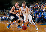BROOKINGS, SD - OCTOBER 30:  Jake Bittle #4 from South Dakota State University drives against Tyler Schoening #40 from South Dakota School of Mines in the first half of their exhibition game Thursday night at Frost Arena in Brookings. (Photo by Dave Eggen/Inertia)