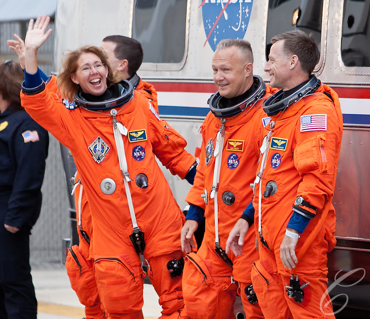 Astronaut Sandy Magnus waves to NASA employees gathered to watch the crew of the Space Shuttle Atlantis leave for the launch pad at Kennedy Space Center on Friday, July 8, 2011.  Atlantis' mission is the final one of the program's 30 year history.