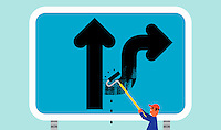 Worker changing direction of arrow on road sign