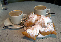 A table setting of coffee and beignets. New Orleans, Louisiana.