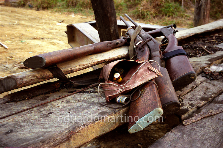 Modern-day Slavery in Brazil<br /> Guns confiscated by the Federal Police during a raid at a farm in South Para. Due to widespread unemployment and poverty, many workers risk their lives and freedom to take work in neighbouring states on farms that use unfree labour. This form of modern-day slavery is implicated most often via a fraudulent debt, used as an excuse to keep workers in the farm while they owe money to the farmer. They are forced to buy everything, from tools to food, from the farmer's shop, at inflated prices. The debt is never cleared and the workers are effectively trapped. The Federal Police and Ministry of Labour work to try and break this cycle of exploitation by raiding farms whenever they receive a tip-off that workers are being mistreated.
