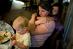 Sharon Ferrell gets a hug from her daugher, Vivian, after dinner at their home in Lincoln, CA May 13, 2009.