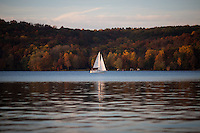 Bill Shaw sails on Lake Lemon on Sunday, Oct. 20, 2014, near Bloomington, Indiana. (Photo by James Brosher)