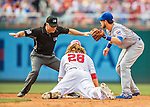 15 June 2016: MLB Umpire Dan Iassogna calls a sliding Jayson Werth safe as Ben Zobrist looks up for the call. The play was overturned after video review during a game between the Chicago Cubs and the Washington Nationals at Nationals Park in Washington, DC. The Cubs fell to the Nationals 5-4 in 12 innings, giving up the rubber match of their 3-game series. Mandatory Credit: Ed Wolfstein Photo *** RAW (NEF) Image File Available ***