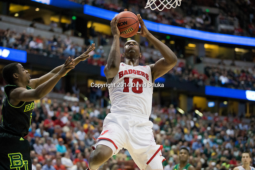 Wisconsin Badgers forward Nigel Hayes (10) shoots the ball during  a regional semifinal NCAA college basketball tournament game against the Baylor Bears Thursday, March 27, 2014 in Anaheim, California. The Badgers won 69-52. (Photo by David Stluka)