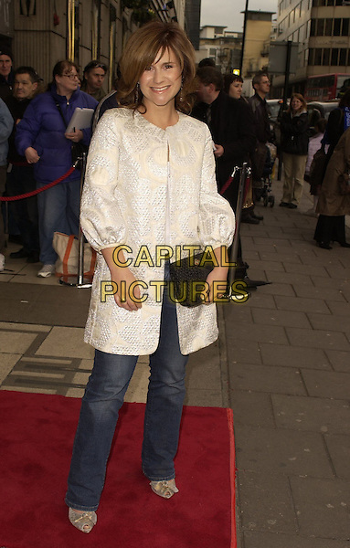 """HARRIET SCOTT.Outside arrivals for """"Movin' Out"""" Opening Night, .Apollo Victoria Theatre, London, England, .April 10th 2006..full length white coat cropped sleeves black clutch bag.Ref: CAN.www.capitalpictures.com.sales@capitalpictures.com.©Can Nguyen/Capital Pictures"""