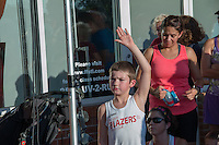 A young runner raises his hand in an effort to ask a question to USA distance running star Meb Keflezghi at the Run with Meb event at Fleet Feet's Des Peres store, Wednesday, September 3, 2014.