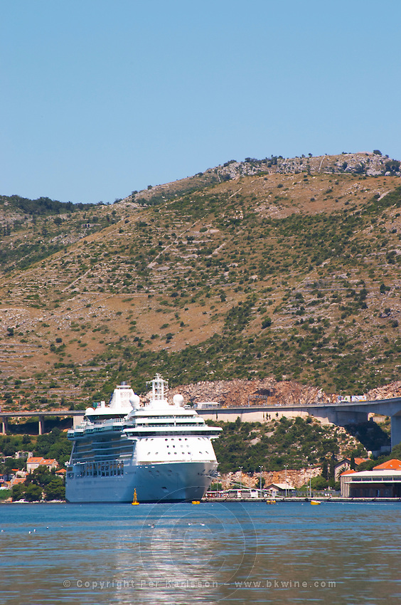 A big luxurious cruising ship. Mountains in the background. Luka Gruz harbour. Dubrovnik, new city. Dalmatian Coast, Croatia, Europe.
