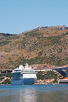 A big luxurious cruising ship. Mountains in the background. Luka Gruz harbour. Dubrovnik, new city. Dalmatian Coast, Croatia, Europe.
