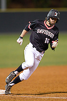 Lee Miller (16) of the Davidson Wildcats rounds third base against the Wake Forest Demon Deacons at Wilson Field on March 19, 2014 in Davidson, North Carolina.  The Wildcats defeated the Demon Deacons 7-6.  (Brian Westerholt/Four Seam Images)