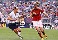 22 MAY 2010:  USA's Ali Krieger #16 and Germany's Simone Laudehr #6 during the International Friendly soccer match between Germany WNT vs USA WNT at Cleveland Browns Stadium in Cleveland, Ohio. USA defeated Germany 4-0 on May 22, 2010.