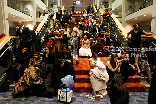 Washington, DC - January 20, 2009 -- Inaugural ball-goers rest on the steps of the Washington Convention Center at the end of a night that featured ten Inaugural Balls to celebrate the swearing-in of US President Barack Obama January 20, 2009 in Washington, DC.  .Credit: Chip Somodevilla - Pool via CNP