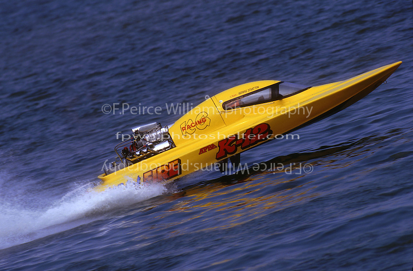 """George Stratton in the enclosed cockpit K Racing Runabout K-12 """"Wild Fire""""..1996 Inboard Nationals, Hampton,VA...F. Peirce Williams .photography.P.O.Box 455 Eaton, OH 45320.p: 317.358.7326  e: fpwp@mac.com."""