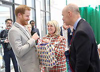 11 April 2019 - Prince Harry, Duke of Sussex speaks shares a joke with Sir Clive Woodward and his wife Lady Jayne Woodward during the official opening of the Barking & Dagenham Future Youth Zone in Dagenham, England.  The facility is created by the Charity OnSide Youth Zones and is the first of three facilities expected to open in 2019, which will provide a safe environment where young people can come and enjoy themselves, build key skills and raise their aspirations and confidence to create a happier and healthier generation. Photo Credit: ALPR/AdMedia