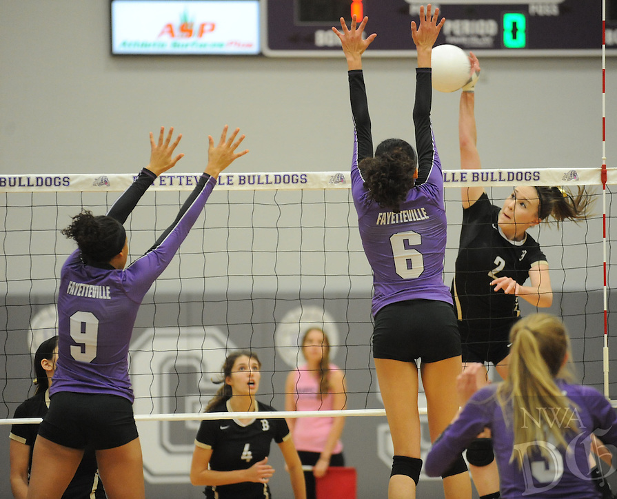 STAFF PHOTO ANDY SHUPE - Anna Leduc (2) of Bentonville sends the ball past Haley Warner (6) and Olivia Thomas (9) of Fayetteville during the Lady Tigers' 25-22, 25-19 and 27-25 win Tuesday, Oct. 21, 2014, at Fayetteville High School.
