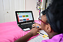 MIRAMAR, FL - MARCH 31: Broward County 13th year old Public school student Jayen in her bedroom in front of her laptops during distance virtual school learning amid Coronavirus Pandemic in Broward County, Florida Public Schools. Florida began their experience with online virtual distance learning, amid the growing coronavirus (COVID-19) pandemic on March 31, 2020 in Miramar, Florida.   ( Photo by Johnny Louis / jlnphotography.com )