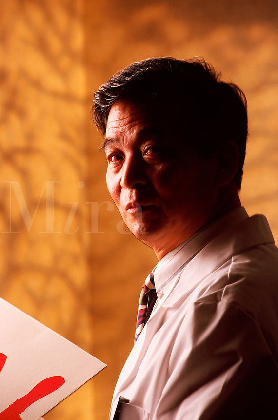 Portrait of a male practitioner of traditional Chinese medicine (TCR).