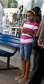 Alexandria, VA - June 20, 2009 -- Sasha Obama enjoys her cup of frozen custard during a Father's Day eve outing with her Dad, United States President Barack Obama during a visit to the Dairy Godmother frozen custard shop in the Del Ray section of Alexandria, Virginia, Saturday, June 20, 2009..Credit: John Harrington - Pool via CNP