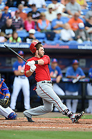 Washington Nationals outfielder Bryce Harper (34) loses his helmet while breaking his bat during a spring training game against the New York Mets on March 27, 2014 at Tradition Field in St. Lucie, Florida.  Washington defeated New York 4-0.  (Mike Janes/Four Seam Images)