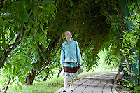 Child, on a path in a summer garden, New Jersey