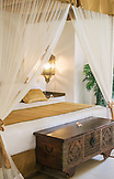 ZANZIBAR, a gold and white canopy bed in the Baraza Hotel