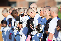 Luke Czajkowski (26) of the Wake Forest Demon Deacons bows his head as he and his teammates stand for the National Anthem prior to the game against the Duke Blue Devils at Wake Forest Baseball Park on April 25, 2014 in Winston-Salem, North Carolina.  The Blue Devils defeated the Demon Deacons 5-2.  (Brian Westerholt/Four Seam Images)