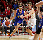 VERMILLION, SD - JANUARY 24: Mike Daum #24 from South Dakota State University drives to the basket against Tyler Hagedorn #25 from the University of South Dakota during their game Wednesday night at the Sanford Coyote Sports Center in Vermillion, SD. (Photo by Dave Eggen/Inertia)