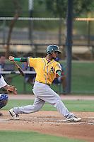 Vicmal De La Cruz #5 of the AZL Athletics bats against the AZL Dodgers at Camelback Ranch on July 12, 2014 in Glendale, Arizona. AZL Athletics defeated the AZL Dodgers, 3-2. (Larry Goren/Four Seam Images)