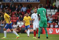 Goalkeeper Caique of Brazil pushes Adam Armstrong (Barnsley, loan from Newcastle United) of England as things get heated during the International match between England U20 and Brazil U20 at the Aggborough Stadium, Kidderminster, England on 4 September 2016. Photo by Andy Rowland / PRiME Media Images.