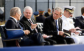 Donald Rumsfeld, former U.S. Secretary of Defense, left, speaks with Robert Gates, U.S. Secretary of Defense, second left, and U.S. President George W. Bush as Michael Mullen, chairman of the Joint Chiefs of Staff sits before the dedication of the September 11th Memorial at the Pentagon on the 7th anniversary of the September 11, 2001 attacks on New York and Washington in Washington, DC, Thursday, September 11, 2008. <br /> Credit: Joshua Roberts / Pool via CNP