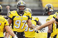 July 12, 2008; Hamilton, ON, CAN; Hamilton Tiger-Cats defensive tackle Darrell Adams (97) prior to the CFL football game against the Saskatchewan Roughriders at Ivor Wynne Stadium. The Roughriders defeated the Tiger-Cats 33-28. Mandatory Credit: Ron Scheffler.