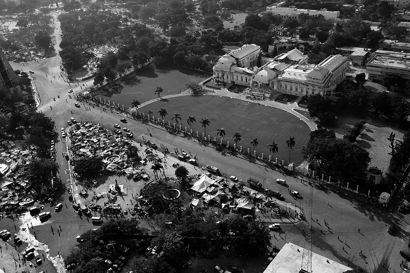 Port Au Prince, Haiti, Jan 20 2010.The 'Palais National' lays almost entirely destroyed, thousands of IDP's are camping in the Cahamp de Mars, the large open area in front. Downtown Port au Prince is one of the most affected areas, with most landmarks suffering extensive damage..