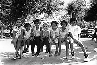 Group of young girls and boys attending a friend's birthday party. Community of Nueva Esperanza, El Salvador, 1999.