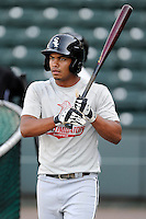 Infielder Cleuluis Rondon (5) of the Kannapolis Intimidators waits to take batting practice before a game against the Greenville Drive on Friday, April 11, 2014, at Fluor Field at the West End in Greenville, South Carolina. Rondon is the No. 26 prospect of the Chicago White Sox, according to Baseball America.  (Tom Priddy/Four Seam Images)